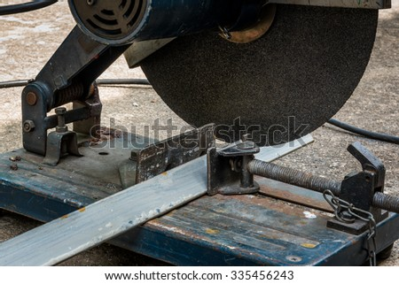 A triangle metal and steel with compound mitre saw with circular blade - stock photo