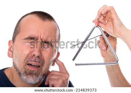A triangle next to the head of a man in agony - stock photo