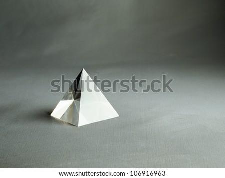 A triangular prism. - stock photo