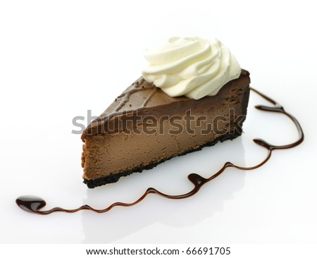A triple chocolate cheesecake with  whipped cream. - stock photo