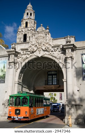 A trolley passes through the archway at the museum of man in San Diego's Balboa Park - stock photo