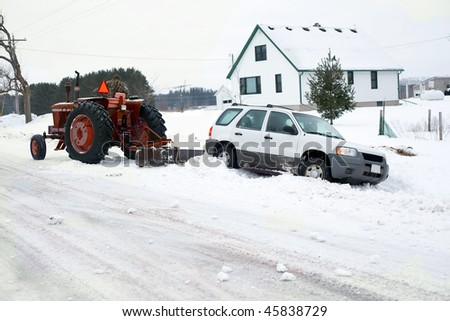a truck being pulled out of the ditch - stock photo