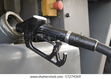 a truck refueling at a gas station before you travel - stock photo