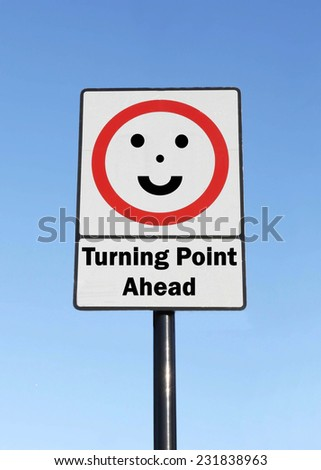 A Turning Point is ahead written on a road sign with a smiling face against a clear blue sky background - stock photo