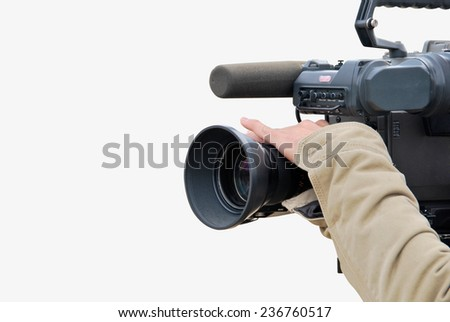 A tv cameraman is operating a camera. Picture isolated over a white background - stock photo