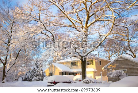 A typical American home covered in snow the morning after a heavy snowfall - stock photo