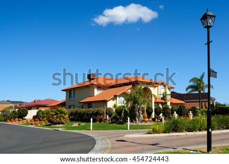 A typical middle-class suburban housing development - stock photo