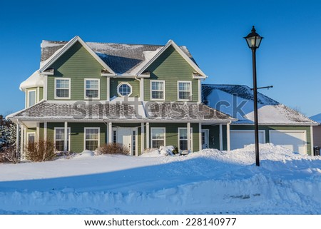 A typical north American family home after a snow storm. - stock photo