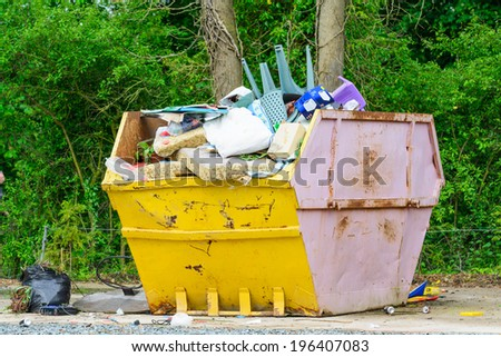 A typical skip or dumpster in the UK - stock photo