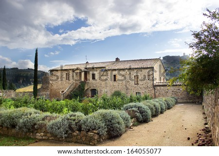 A typical tuscan country house, a medieval building near Siena, Tuscany, italy - stock photo
