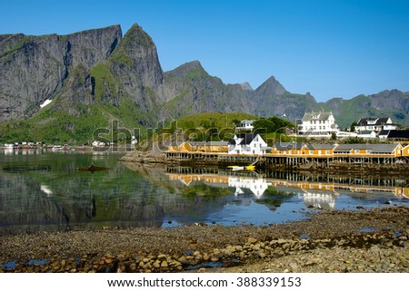 A typical village on the islands of Norway on the background of rocks - stock photo