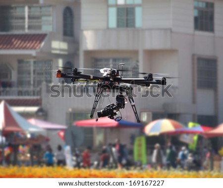 A UAV or drone with a digital camera mounted on it - stock photo