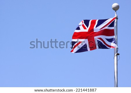 A union jack flapping in the wind on a clear day - stock photo