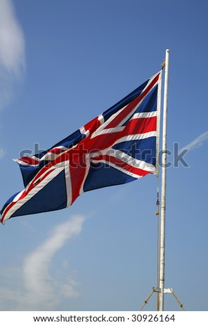 A Union Jack on a flag pole. - stock photo