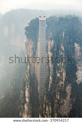 A unique lift for tourists to rock column mountain . Zhangjiajie National Forest Park was officially recognized as a UNESCO World Heritage Site - China  - stock photo