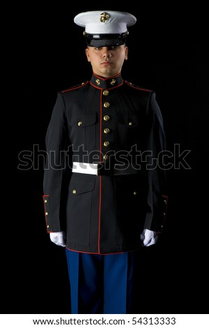 A United States Marine wearing Dress Blues in a studio environment - stock photo
