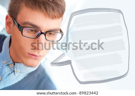 A university college student or casual good looking man wearing glasses portrait. Looking away. Blank balloon with his thoughts for your text and logo - stock photo