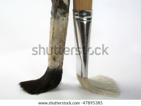 a used and a new brush - stock photo