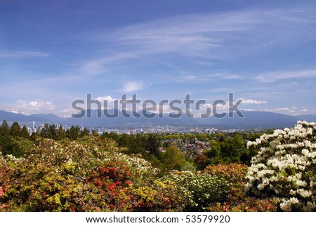 A Vancouver downtown view with flower and mountain background. - stock photo