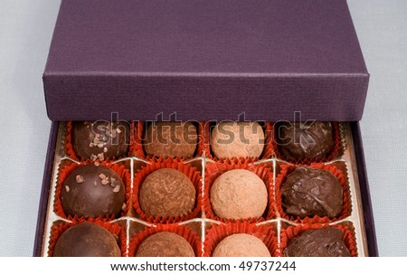 a variety of chocolate truffles in gift box - stock photo