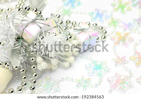 A variety of colorful snowflake shapes and tiny present Christmas decorations. - stock photo