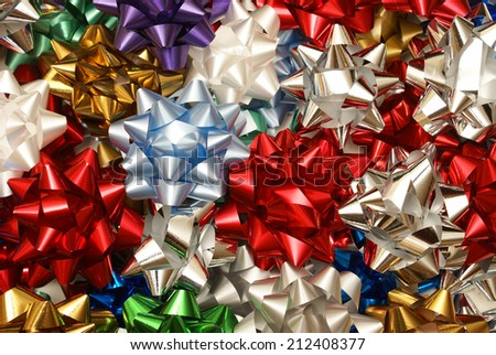 A variety of decorative Christmas bows to spice up the gift giving holiday. - stock photo