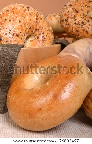 A variety of freshly baked bagels including plain, cinnamon raisin, blueberry, and Everything - stock photo