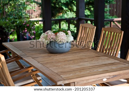 A vase of flowers on the table - stock photo