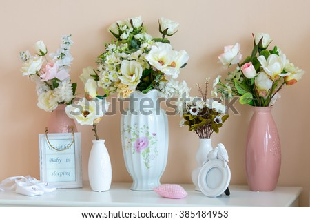 a vase with flowers on a white envelope - stock photo