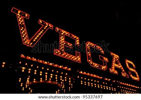 a Vegas illuminated sign at night - stock photo