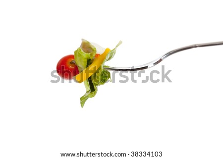 a vegetable salad on a fork with a white background - stock photo