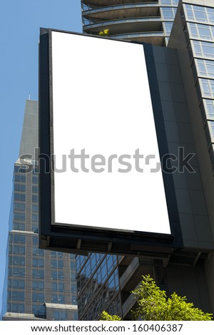 A vertical blank urban billboard with copy space - stock photo