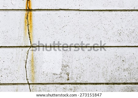 A vertical crack in a stone wall - stock photo