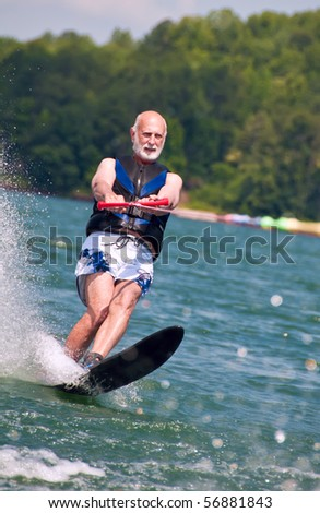 A very active senior still ski's at age 62 - stock photo