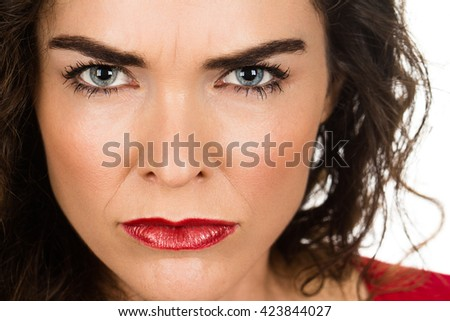 A very annoyed angry and woman. Isolated on white. - stock photo