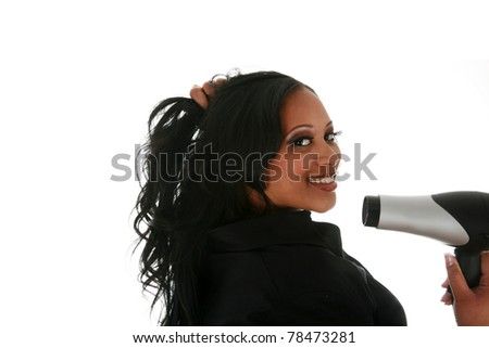 A very beautiful african american woman blow drying her hair. isolated on white with room for your text - stock photo