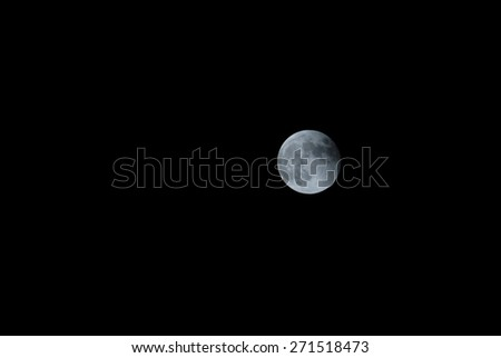 A Very Big Full White Moon on the Black of the Night. - stock photo