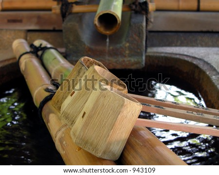 a very characteristic Japanese aspect of a bamboo fountain and its tools,used for hands washing at the entrance in the each temple as a symbol of purification. - stock photo