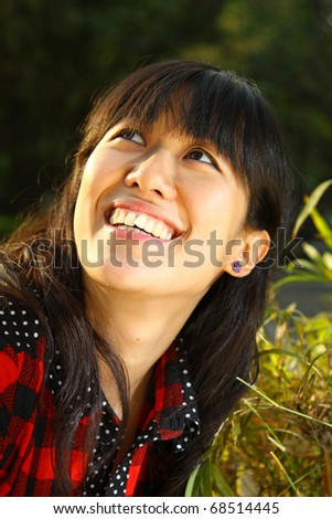 A very cheerful Chinese girl smiling - stock photo