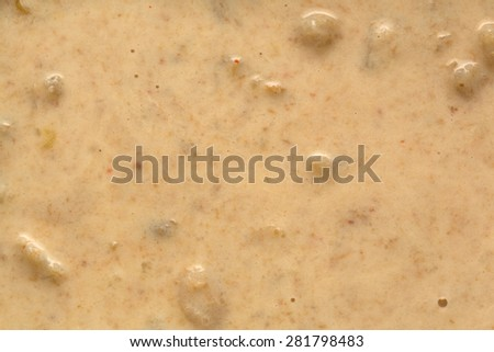 A very close view of cooked lobster corn chowder. - stock photo