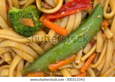 A very close view of pasta, noodles and vegetables. - stock photo