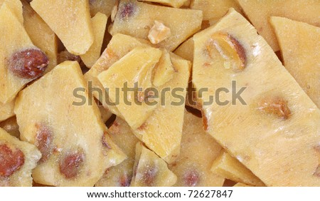 A very close view of peanut brittle candy. - stock photo