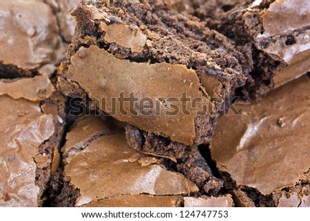 A very close view of several home baked chocolate brownies. - stock photo