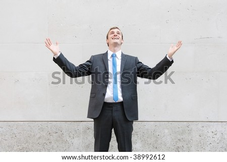 A very happy business man in London, Europe - stock photo