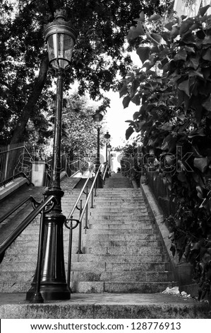 A very long staircase with an old street lamp in Montmartre, Paris, France. Black and white - stock photo