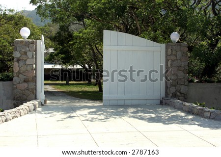 A very nice White wooden  Gate Entrance - stock photo