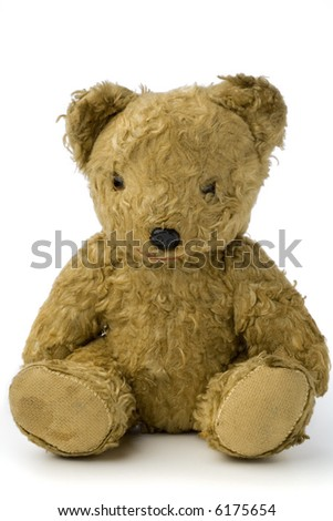 a very old and shabby teddy bear on white - stock photo