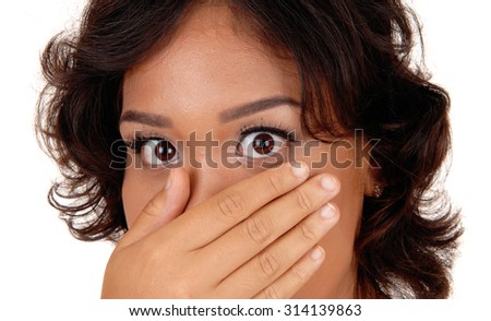 A very surprised mixed raised woman with her hand over her mouth and