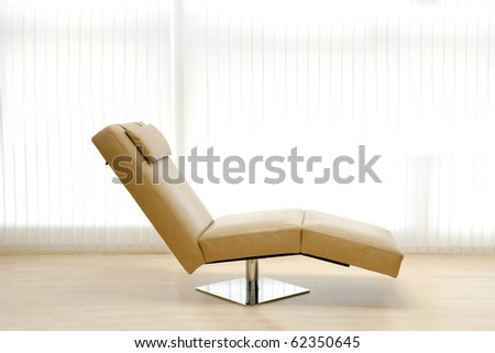 A very trendy leather sofa in a room. - stock photo