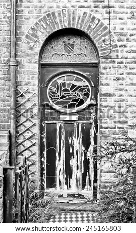 A very weathered black front door - stock photo